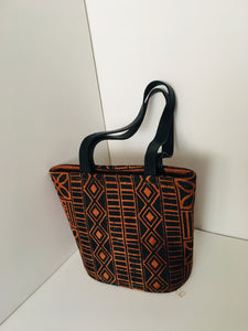Handcrafted Handbag made out of Backcloth Materials with leather material Handles.
