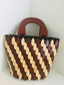 Handcrafted handbag in Brown and off white made out of wooden materials.