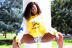 Yellow sweatshirt with white sleeve and blue arm patch accent