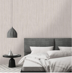This gorgeous grey and rose gold textured linen type wallpaper with thin vertical lines is the perfect addition to any bedroom wall