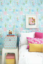 This bright and colourful pink, green, and turquoise pattern with turn any wall into a dreamy scene of wonderment.