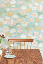 This patterned wallpaper with turquoise and flowers will add class and glamour to any room