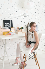 This Confetti Black Wallpaper design is a soft, subtle and dreamy. Perfect Wallpaper for many room, including nursery and children's rooms with the cream and black polka dots on a light background.