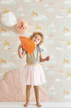 Rainbows, soft clouds, and unicorns, sounds perfect for a young girl's room, or nursery.