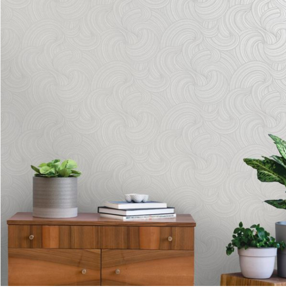This swirling textured design is light grey has shimmering metallic hints to the shine which make an big impact in any room.