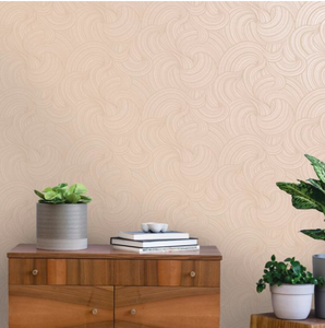 Light pink wall covering with textured swirls and metallic shine to the wallpaper.