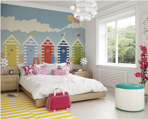 This beach bungalow feature wall is a great way to inject some imaginative adventure into any room. Beach Huts Wall Mural shows colourful beach huts in front of a sunny blue sky.