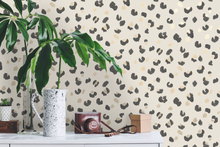 this colourful animal print wallpaper design with the leopard colours of black, cream and browny gold will look fabulous in a kitchen, hallway or powder room.