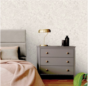 Roomshot of cream floral patterned wallpaper