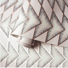 The triangle patterns in a soft pink colour with grey and metallic makes for a very interesting pink and grey wallpaper design.