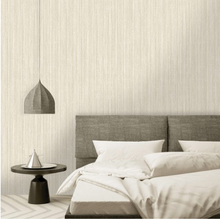 This gorgeous gold wallpaper with thin stripes and metallic sheer is so impactful.
