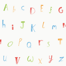 Multi colour letters of alphabet on white background.