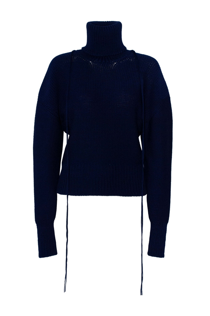 working title product shot of blue fringe knit turtleneck jumper