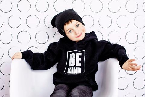 Little boy wearing a Be Kind Autism Awareness sweater