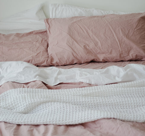 Bedding with waffle blanket on it