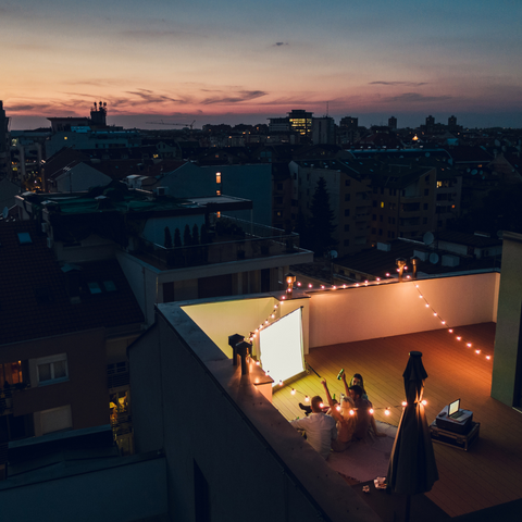 An outdoor movie night on top of a condo rooftop