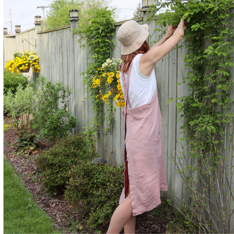A woman outside in her backyard planting