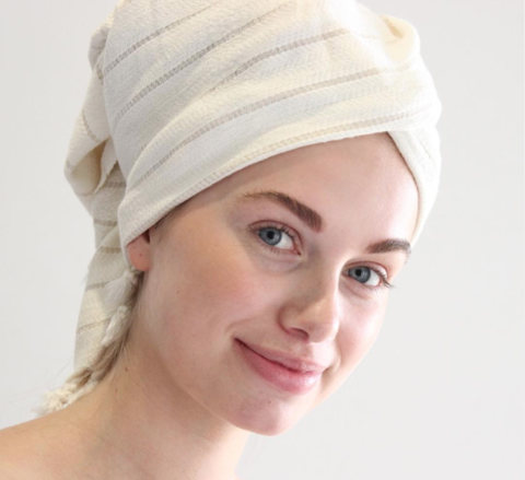 Girl with Turkish Towel wrapped around her hair on her head
