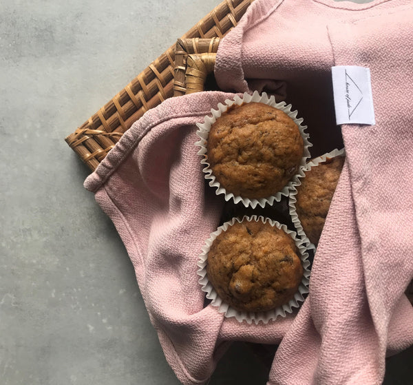 Basket of Banana Chocolate Chip muffins in a tea towel