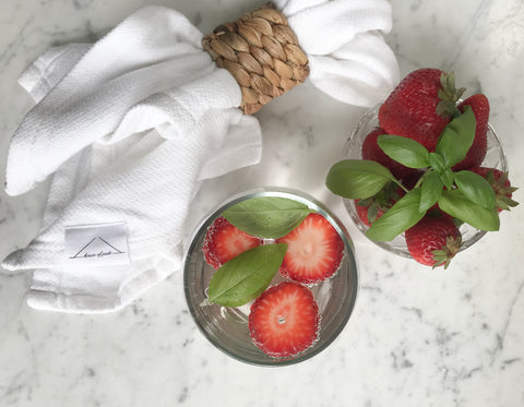 Cloth Napkin with fresh strawberries and strawberry basil infused water
