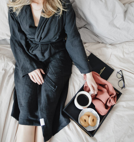 Girl wearing Turkish Cotton Robe in bed with a tray with coffee and cookies and wash cloth