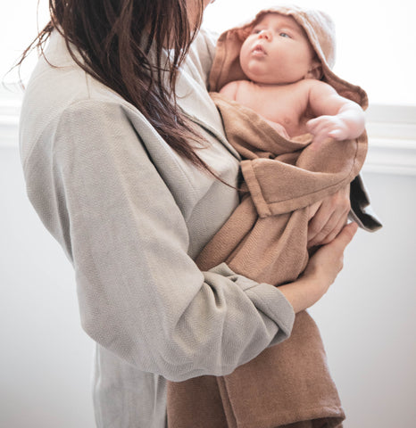 Mom in Turkish Towel Robe holding baby in Hooded Baby Towel