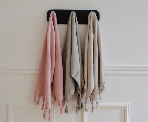 Three Turkish Hand Towels hanging from a hanger