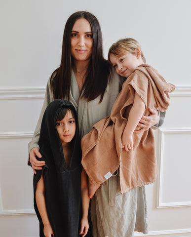 A mother in a robe and her two sons