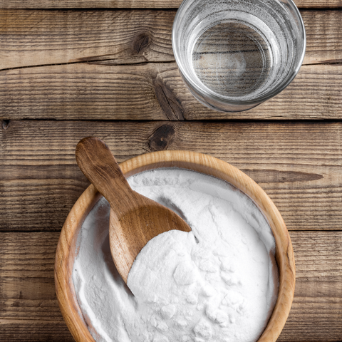 Bowl of baking soda with a glass of vinegar