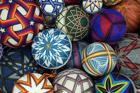 Bowl of Japanese temari balls in array of colors and patterns