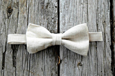 Irish linen bow tie in oatmeal on wood background