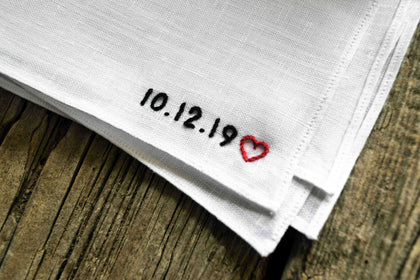 White linen pocket square hand embroidered with a date and small heart