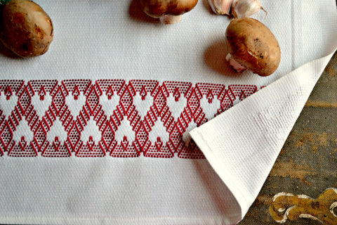 Tea towel hand embroidered with red hearts design with portobello mushrooms