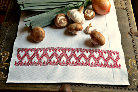 Hand embroidered kitchen towel in white and red with mushrooms and garlic