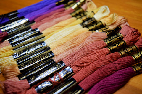 rainbow of embroidery floss shades from yellows to reds and purples