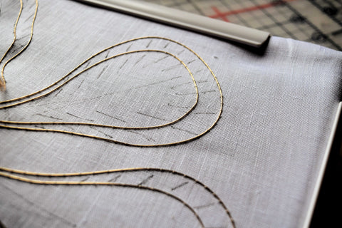 wire couched down on linen to embroider stumpwork iris petals