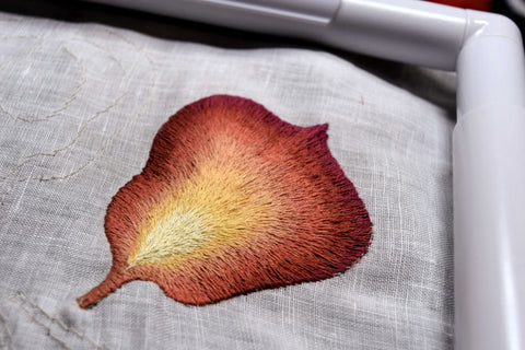 Backside of hand embroidered iris petal, showing no knots or gaps