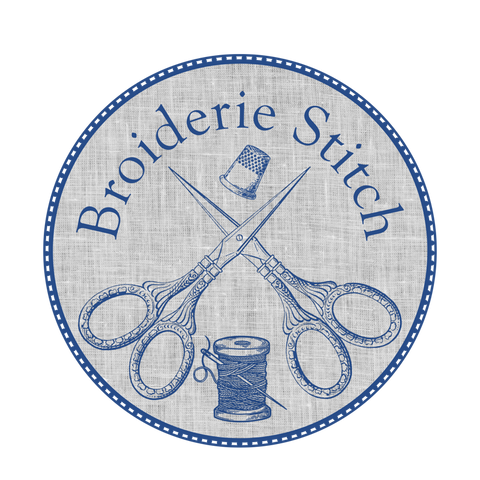 Circular seal in blue and white, depicting crossed embroidery scissors over a spool of thread, surmounted by a thimble and the name Broiderie Stitch