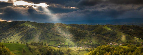 Romanian countryside under broken clouds