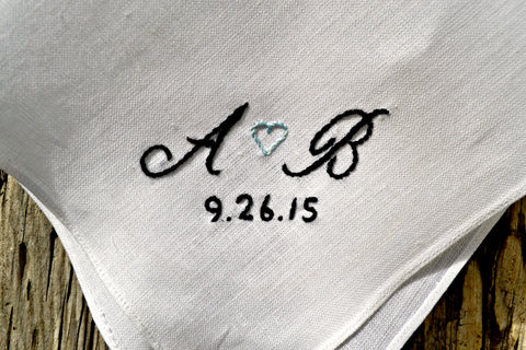 White linen handkerchief hand embroidered with A heart B and wedding date in black and soft blue