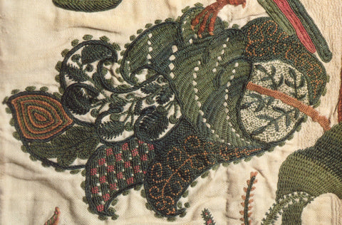 Very stylized crewel embroidery leaf in green