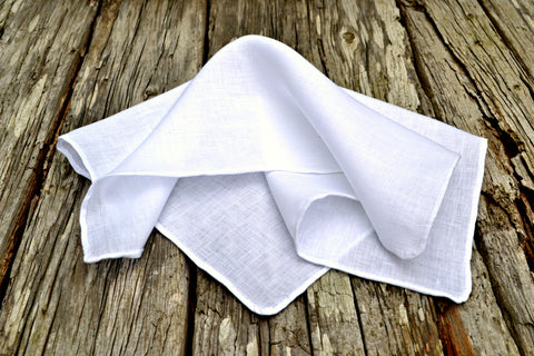 white linen handkerchief with hand rolled hem