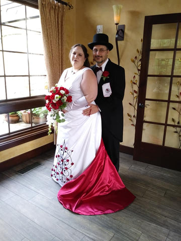 Wedding dress with roses and red train