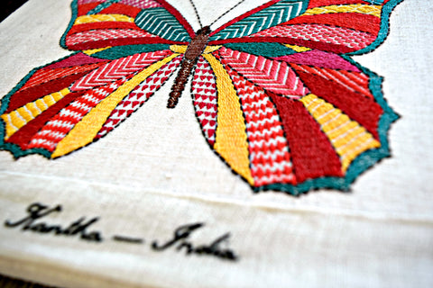 Close-up of brightly colored butterfly worked in kantha embroidery