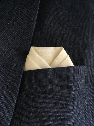 Cream pocket square in suit pocket