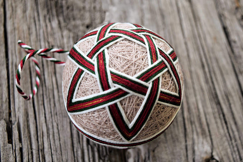 Christmas temari ball with woven pattern in red and green