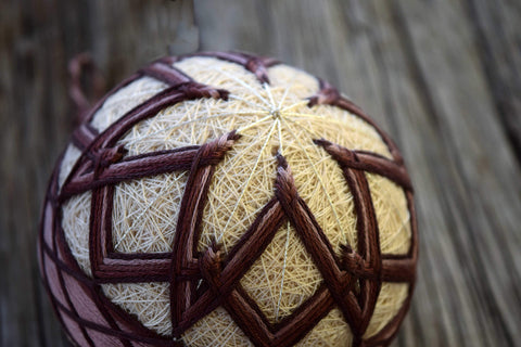 Muted purple temari ball in kiku design