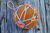 Japanese gold temari ball with orange and blue design