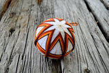 Terracotta temari ball in orange and yellow
