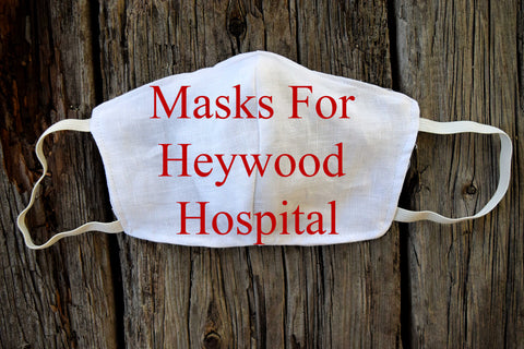 Face Mask with 'Masks For Heywood Hospital' across it